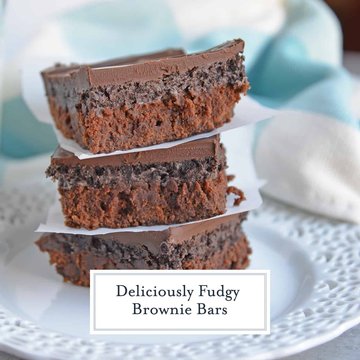 Fudgy Brownie Bars are an easy dessert recipe with layers of brownie, cookie and chocolate ganache, the ultimate chocolate lovers dream! #fudgybrownies #cookiebrownies www.savoryexperiments.com