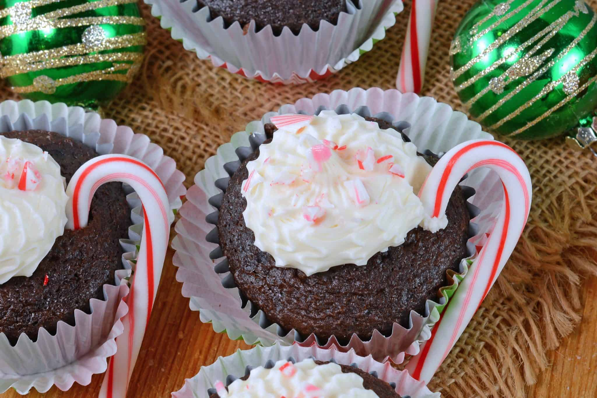 Peppermint Mocha Cupcakes use doctored up box mix, marshmallow creme frosting and candy canes for the ultimate kid-friendly cupcake recipe! #mochacupcakes #christmascupcakes www.savoryexperiments.com