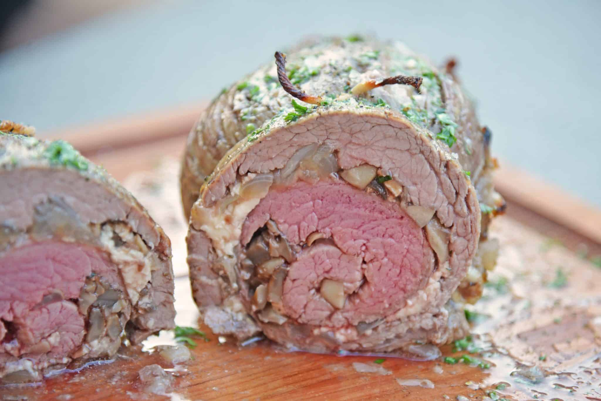 Mushroom Cheese Stuffed Flank Steak is a delicious and succulent main dish with cheese, mushrooms and garlic. The best flank steak pinwheel recipe! #stuffedflanksteak #flanksteakrecipe www.savoryexperiments.com