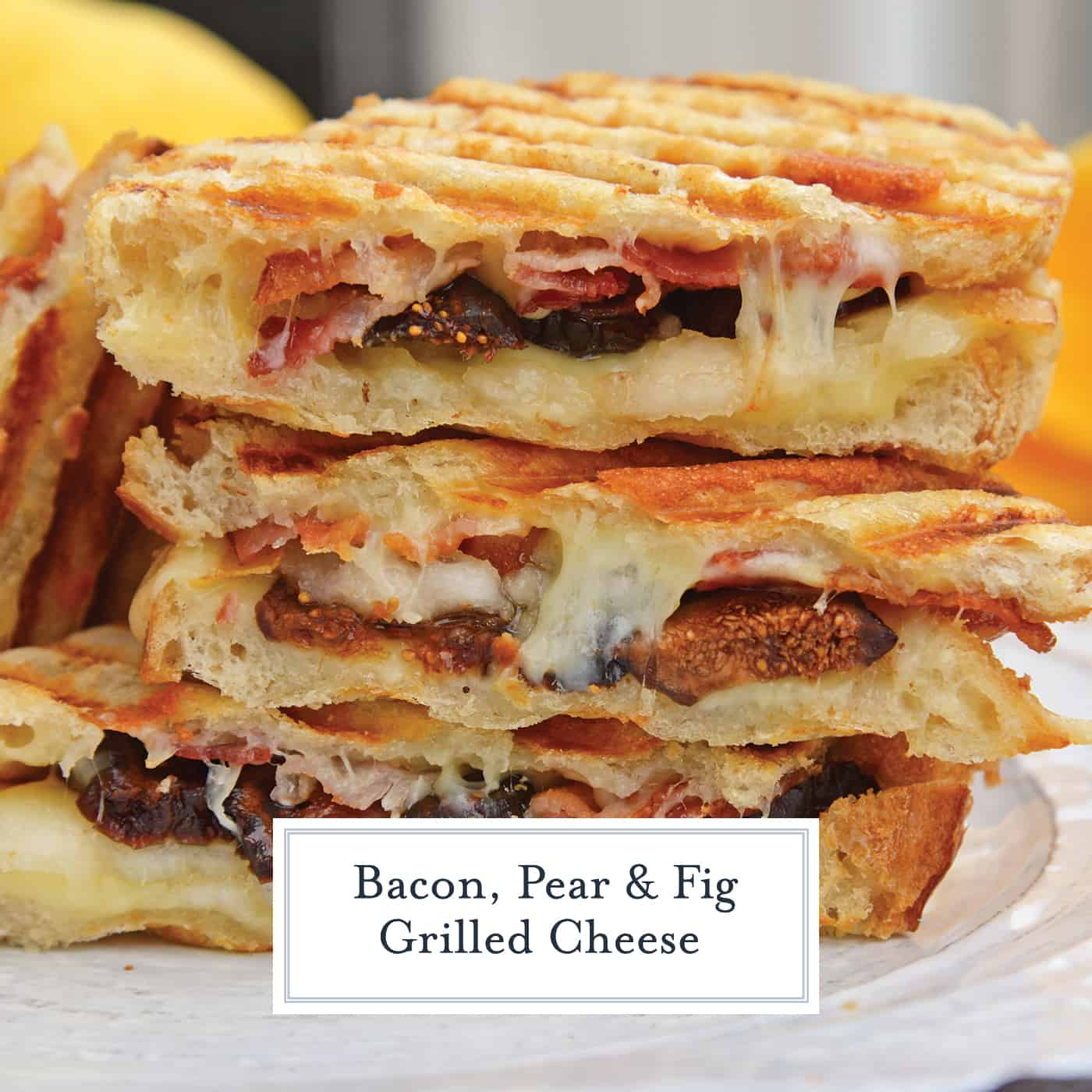 This Bacon, Pear and Fig Grilled Cheese combines sweet, savory and gooey. The ultimate grilled cheese! #gourmetgrilledcheese www.savoryexperiments.com