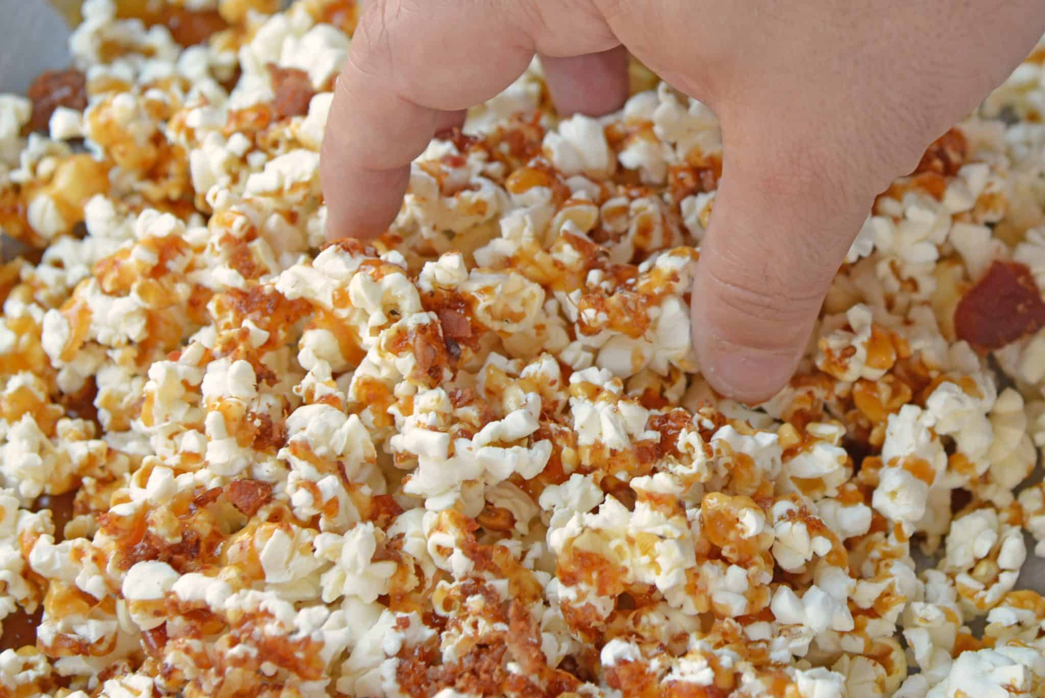 This Bacon Caramel Popcorn is the perfect blend of sweet and salty. Perfect for parties, snacks and dessert! #popcornrecipes #caramelpopcornrecipe www.savoryexperiments.com