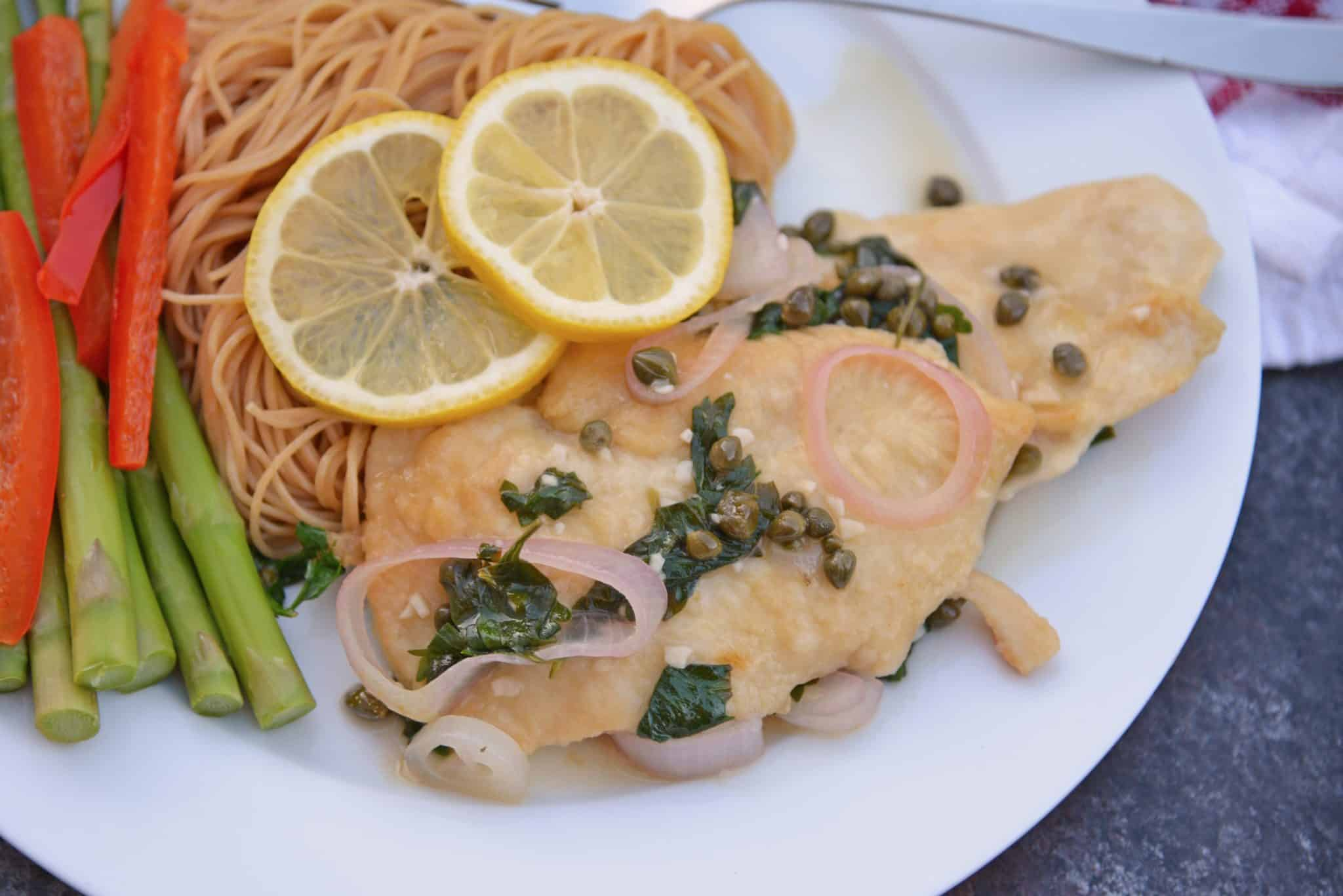 Classic Chicken Piccata is an easy Italian recipe that comes together in less than 3o minutes and explodes with flavors of lemon, caper and shallot. Delicious!  #chickenpiccata #easyitalianrecipes www.savoryexperiments.com