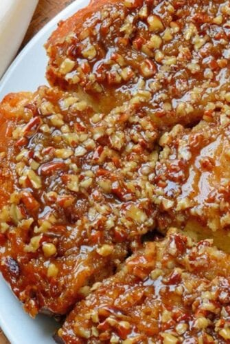 Pecan Sticky Buns are the best hot sticky bun recipe out there, made just the way grandma on the farm made them with a caramel pecan sauce.#stickybuns #stickybunrecipe www.savoryexperiments.com