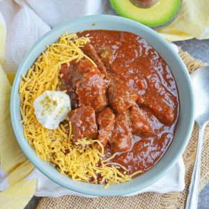Red Beef Chili uses chunks of steak and simmers them to tender perfection in a chili tomato sauce. Serve over rice, noodles or as a stew. #bestchilirecipe #bobbyflay #redbeefchili www.savoryexperiments.com