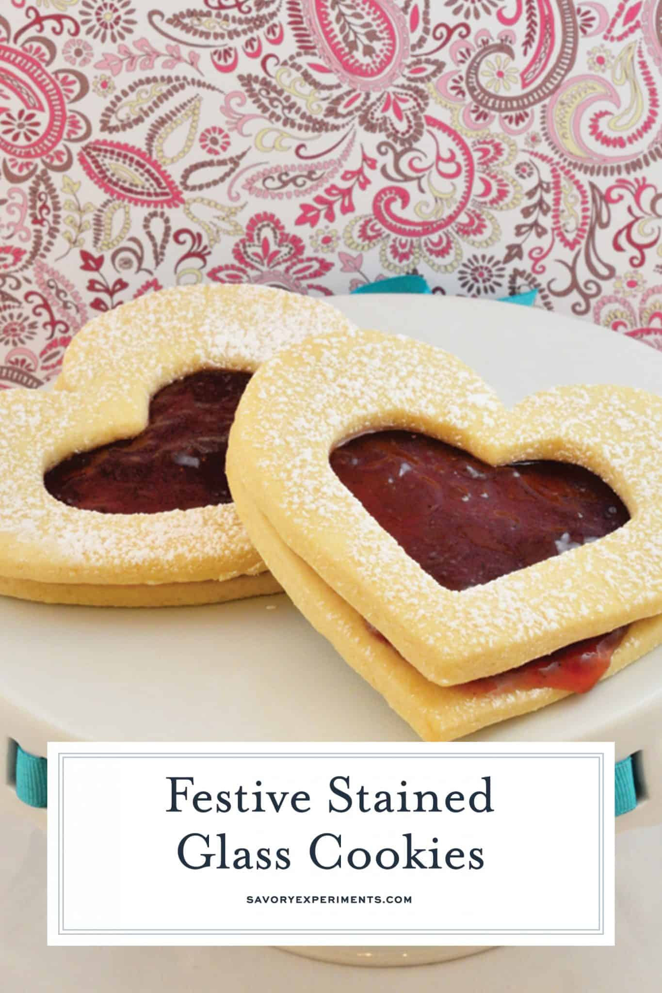 Stained Glass Cookies are the perfect sweet treat for Valentines Day! A delicious sugar cookie sandwich with strawberry jam in the middle! #stainedglasscookies #cookiesforvalentine'sday #jamcookies www.savoryexperiments.com