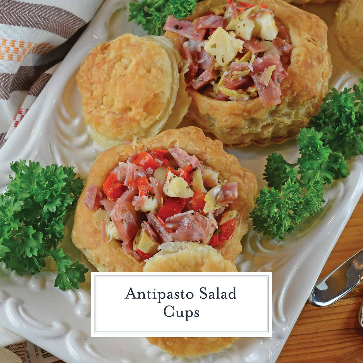 Antipasto Salad Cups are made of chopped salami, prosciutto, sopressata, mozzarella cheese, peppadews and artichokes. The best way to eat salad with your fingers!