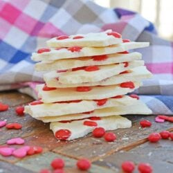 This is an easy Cinnamon Bark recipe that can be ready in just 10 minutes and made with white chocolate and cinnamon candies. #almondbark #recipesthatuseredhots www.savoryexperiments.com