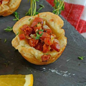 Citrus Sausage Cups are an easy appetizer using smoky andouille sausage, orange zest, sweet onion and fresh thyme in a puff pastry cup. #puffpastryappetizers #puffpastrycups www.savoryexperiments.com