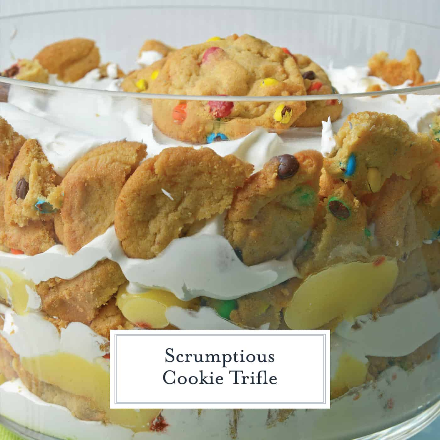 This Cookie Trifle recipe is a super easy trifle recipe that only uses 3 ingredients! Chocolate and butterscotch chip cookies, layered with vanilla custard and whipped cream! #cookiebomb #cookietrifle #triflerecipe www.savoryexperiments.com