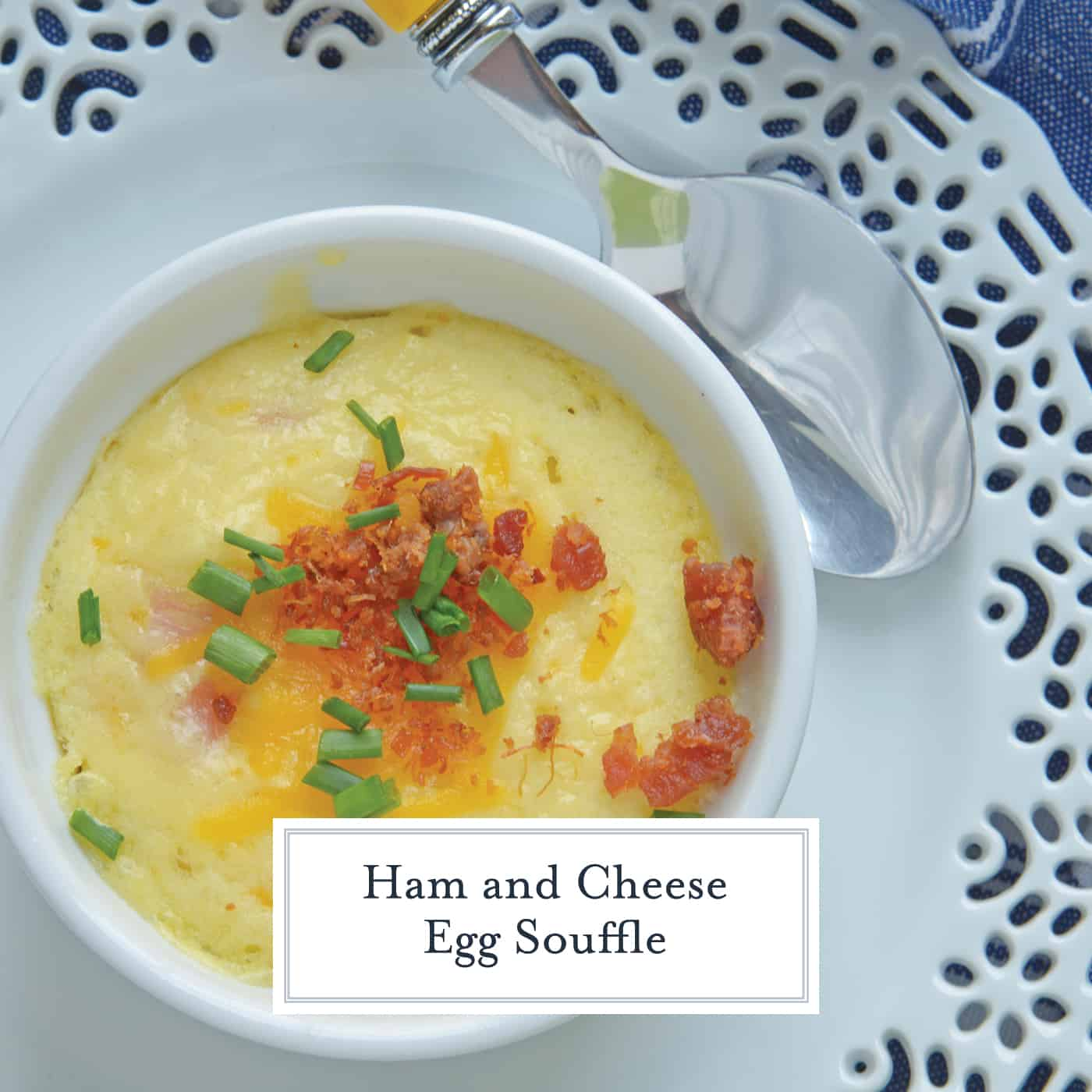 This Ham and Cheese Egg Soufflé recipe is perfect for breakfast or brunch, and great for a crowd! Made up of eggs, ham, cheddar cheese, bacon, and chives! #eggsoufflé #cheesesoufflé #soufflérecipe www.savoryexperiments.com