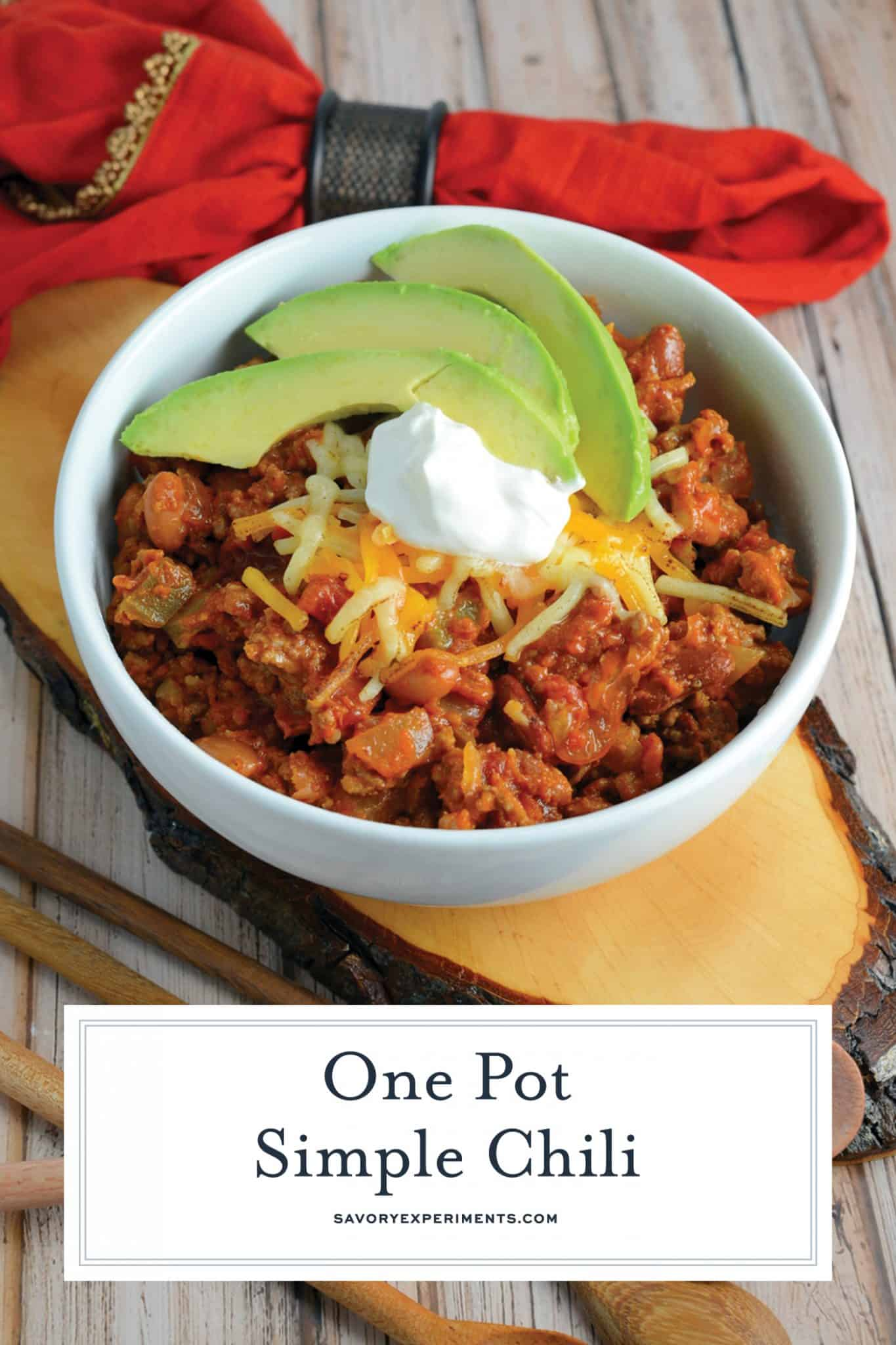 This Simple Chili only takes 30 minutes to throw together and will leave you wanting more. Lean beef, a blend of beans and spices, plus tomatoes and peppers make this packed with healthy ingredients.#simplechili #homemadechili #easychilirecipe www.savoryexperiments.com