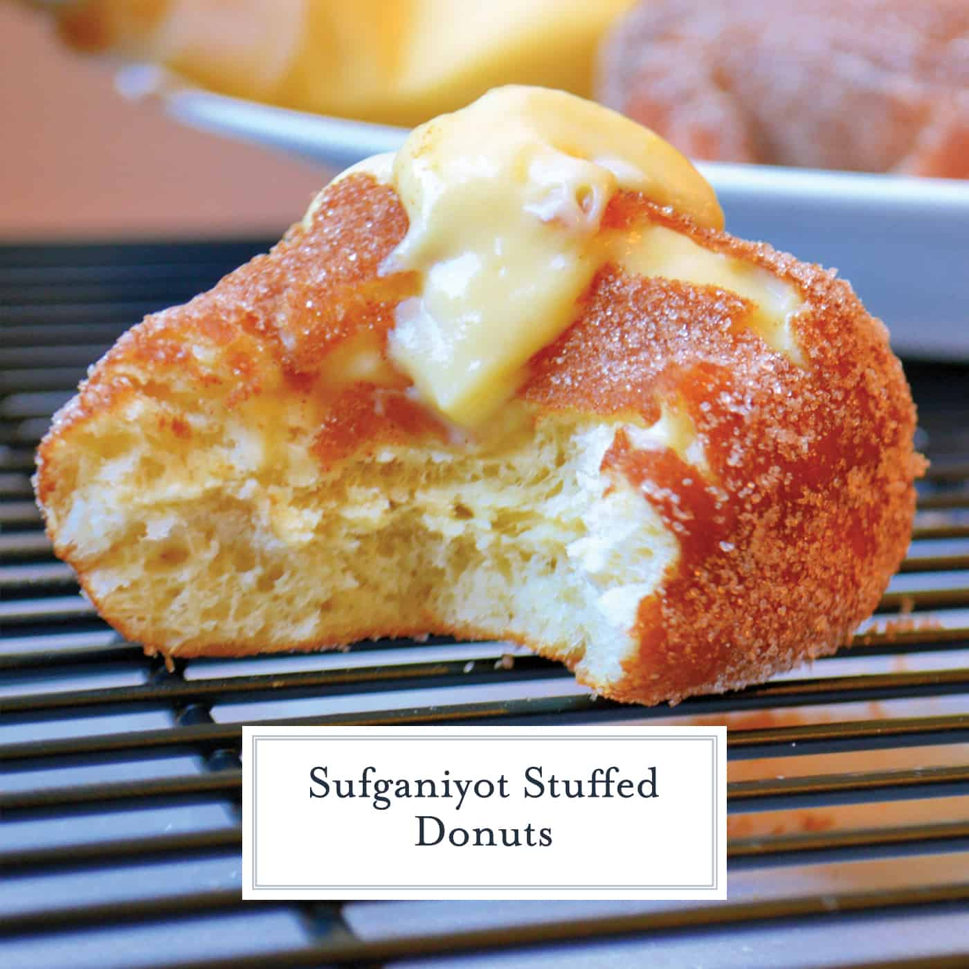 Sufganiyot Stuffed Donuts let you prepare warm & fresh strawberry jelly & vanilla custard stuffed donuts at home! Light & fluffy dough with a hint of sugar! #donutrecipe #stuffeddonuts #easysufganiyotrecipe www.savoryexperiments.com