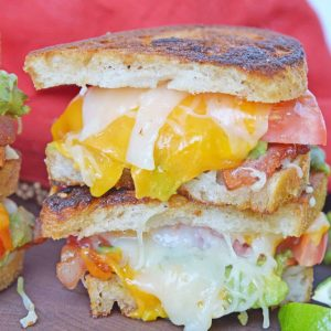 Bacon Avocado Grilled Cheese Sandwiches are made from a three cheese blend along with zesty guacamole, lime, and bacon, for out of this world sandwich experience! #howtomakegrilledcheese #gourmetgrilledcheese #avocadogrilledcheese www.savoryexperiments.com