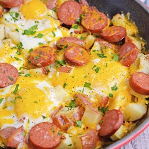 Sausage and Egg Skillet is a delicious breakfast skillet with andouille sausage, potato, eggs and gooey cheese. Ready in 30 minutes and perfect for special weekend brunch! #breakfastskilletrecipe #castironskilletrecipes www.savoryexperiments.com