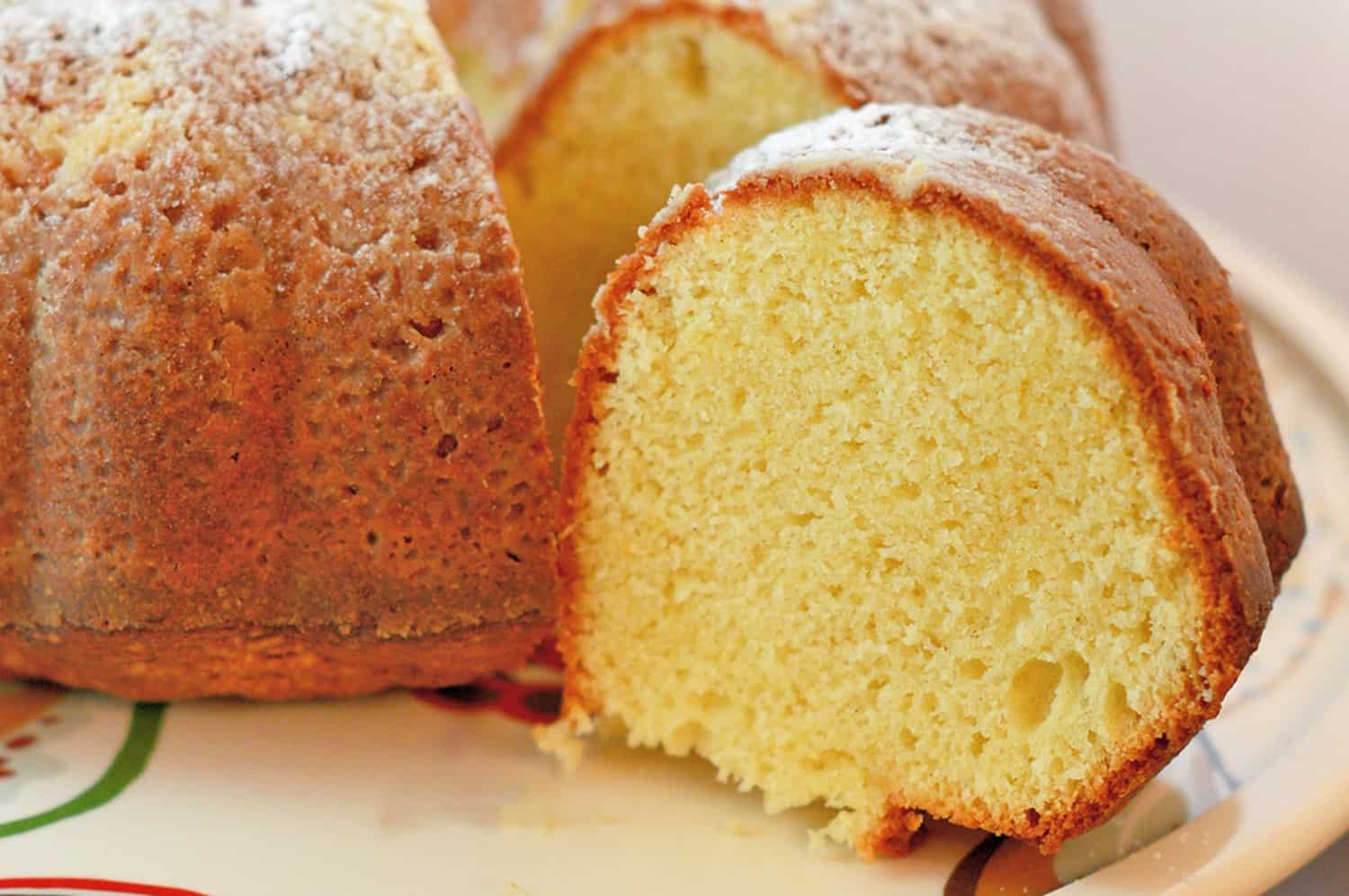 Cardamom Lemon Cake is a light cake and gently flavored. It pairs perfectly with tea, coffee or the grand finale to any meal. The perfect lemon bundt cake! #lemoncake #lemonbundtcake www.savoryexperiments.com
