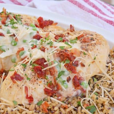 Creamy Garlic Chicken is an easy chicken recipe for dinner using a homemade cream sauce, parmesan cheese, bacon, peas and sun dried tomatoes. A chicken dinner idea ready in just 30 minutes.#chickendinnerideas #chickenrecipesfordinner www.savoryexperiments.com