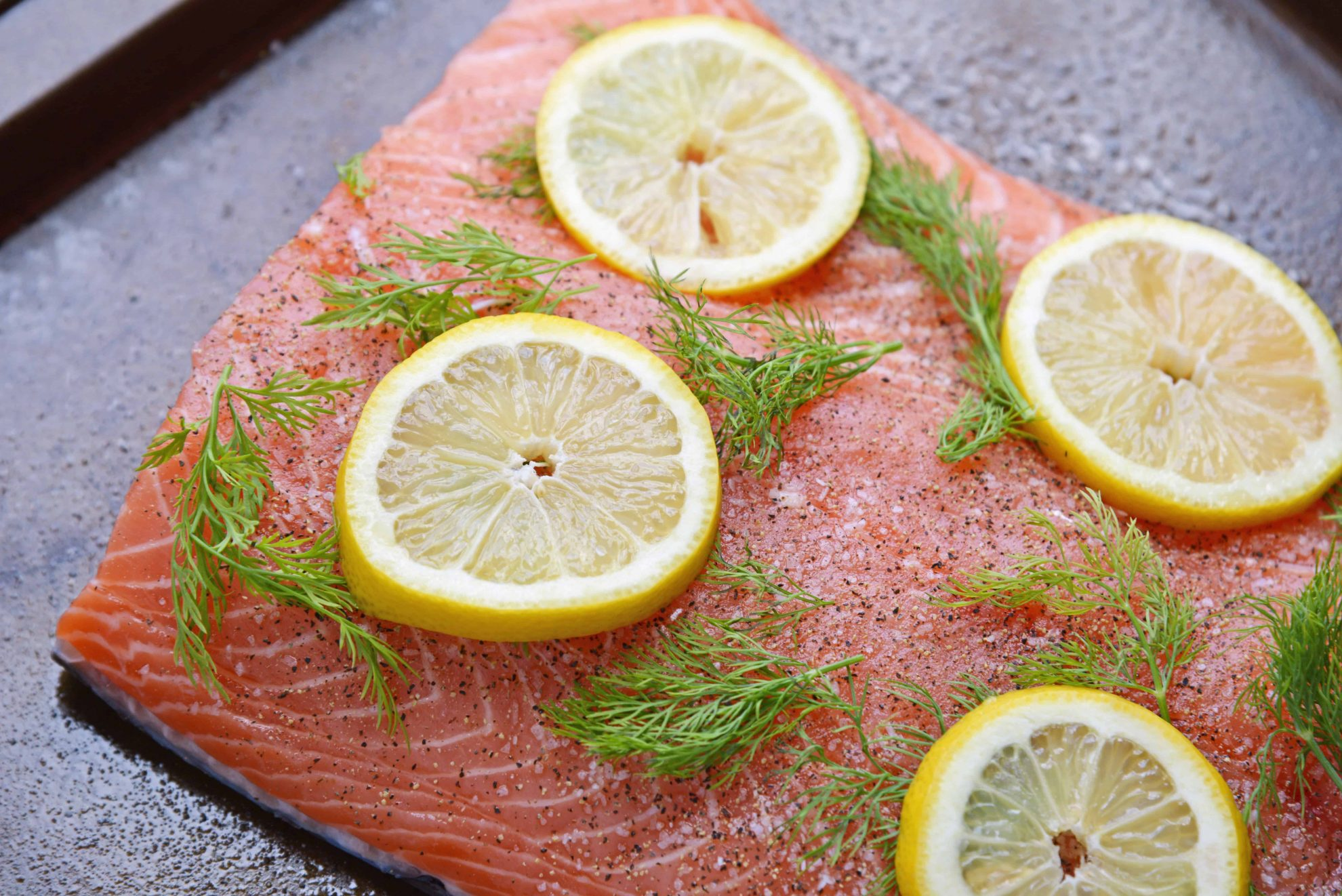 Raw salmon with fresh dill and lemons