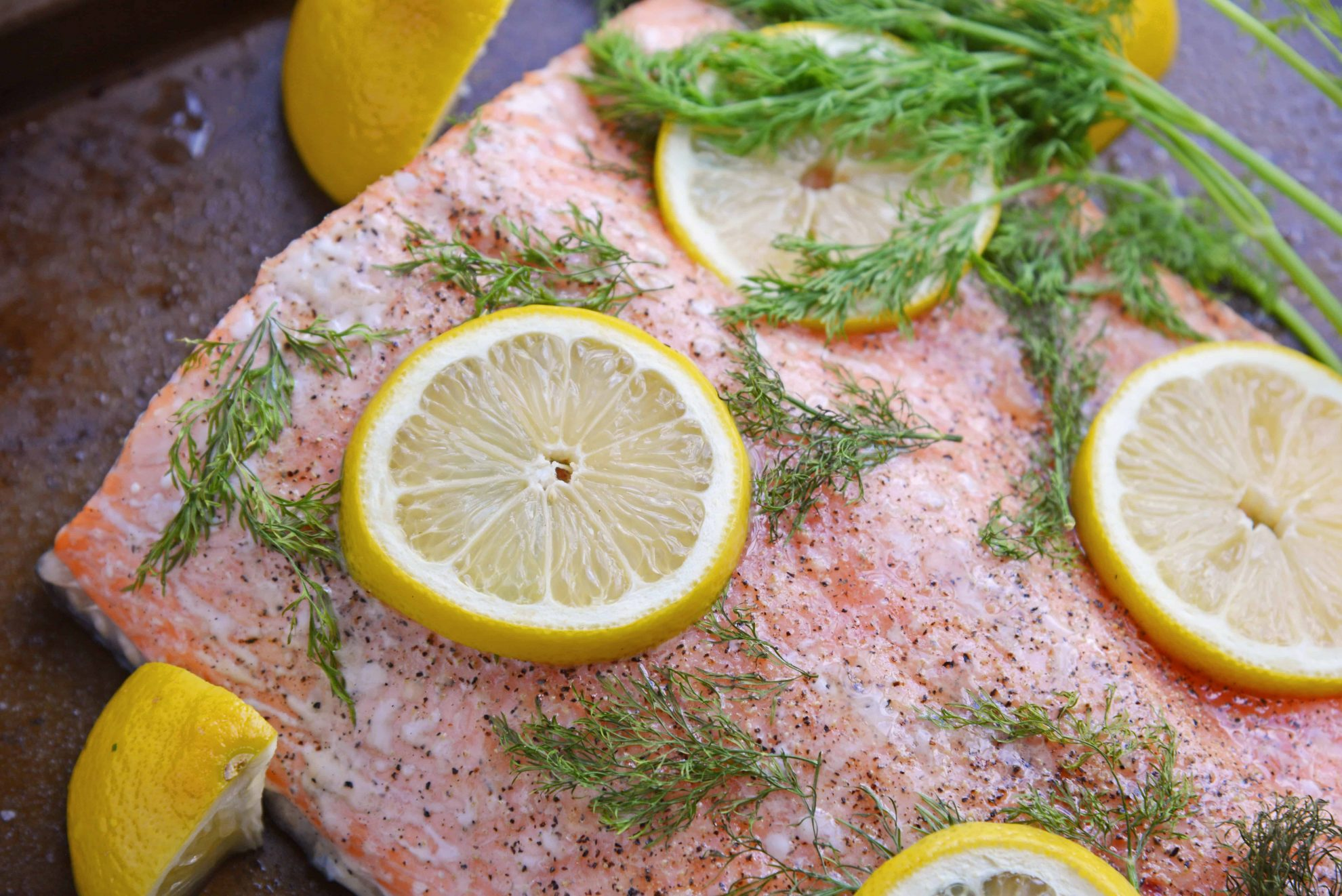 Healthy baked salmon with fresh lemons and dill