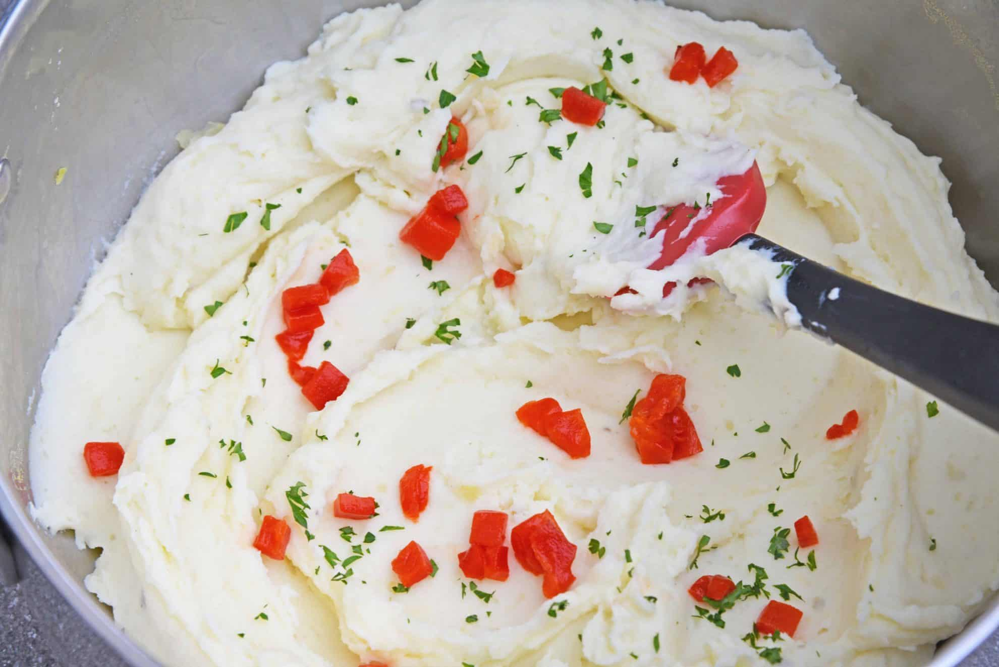 Mascarpone Mashed Potatoes take traditional mashed potatoes up a notch by adding creamy mascarpone and roasted red peppers! #howtomakemashedpotatoes #bestmashedpotatoes www.savoryexperiments.com