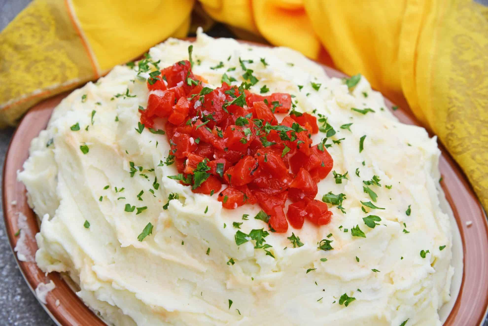 Mascarpone Mashed Potatoes take traditional mashed potatoes up a notch by adding creamy mascarpone and roasted red peppers!#howtomakemashedpotatoes #bestmashedpotatoes www.savoryexperiments.com