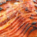 Peach and Riesling Baked Ham Recipe- Beautifully caramelized Baked Ham with Peach Brown Sugar Glaze. Perfect Easter dinner idea or make for Sunday supper. Feeds a crowd and it easy to make! www.savoryexperiments.com