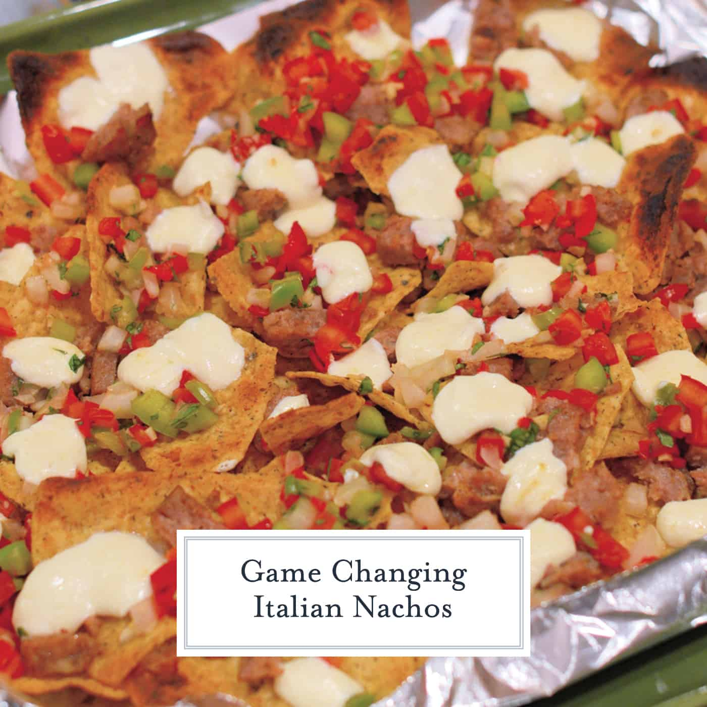Italian Nachos are a new twist on an old favorite.Crunchy, spicy, and loaded with toppings, these are about as addictive as they come. #italiannachos #nachos www.savoryexperiments.com