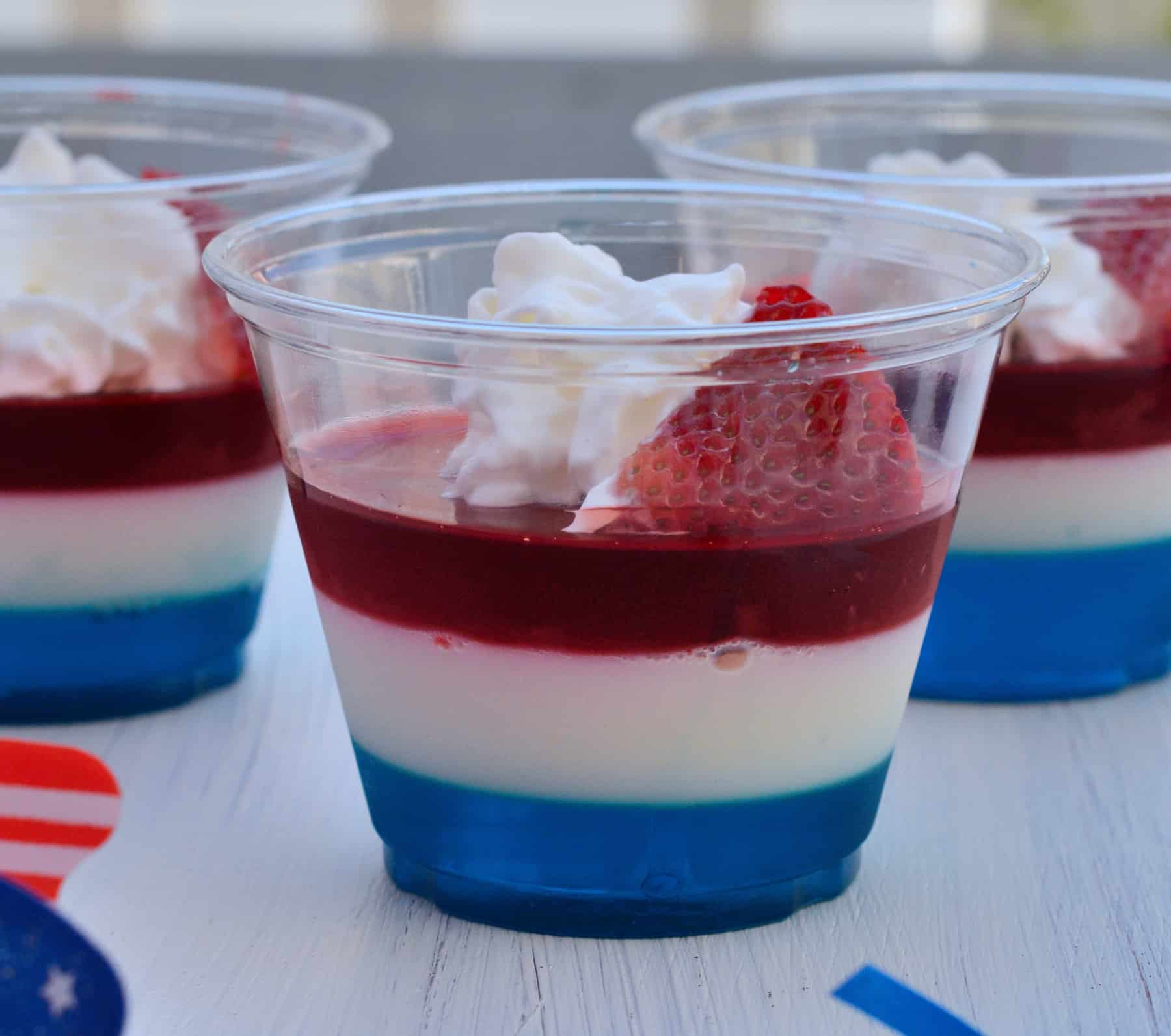 Red, White and Blue JELL-O Cups are a simple and festive addition to any summertime celebration. Easy to make and unbelievably tasty! #redwhiteandbluejellocups #jellocups www.savoryexperiments.com