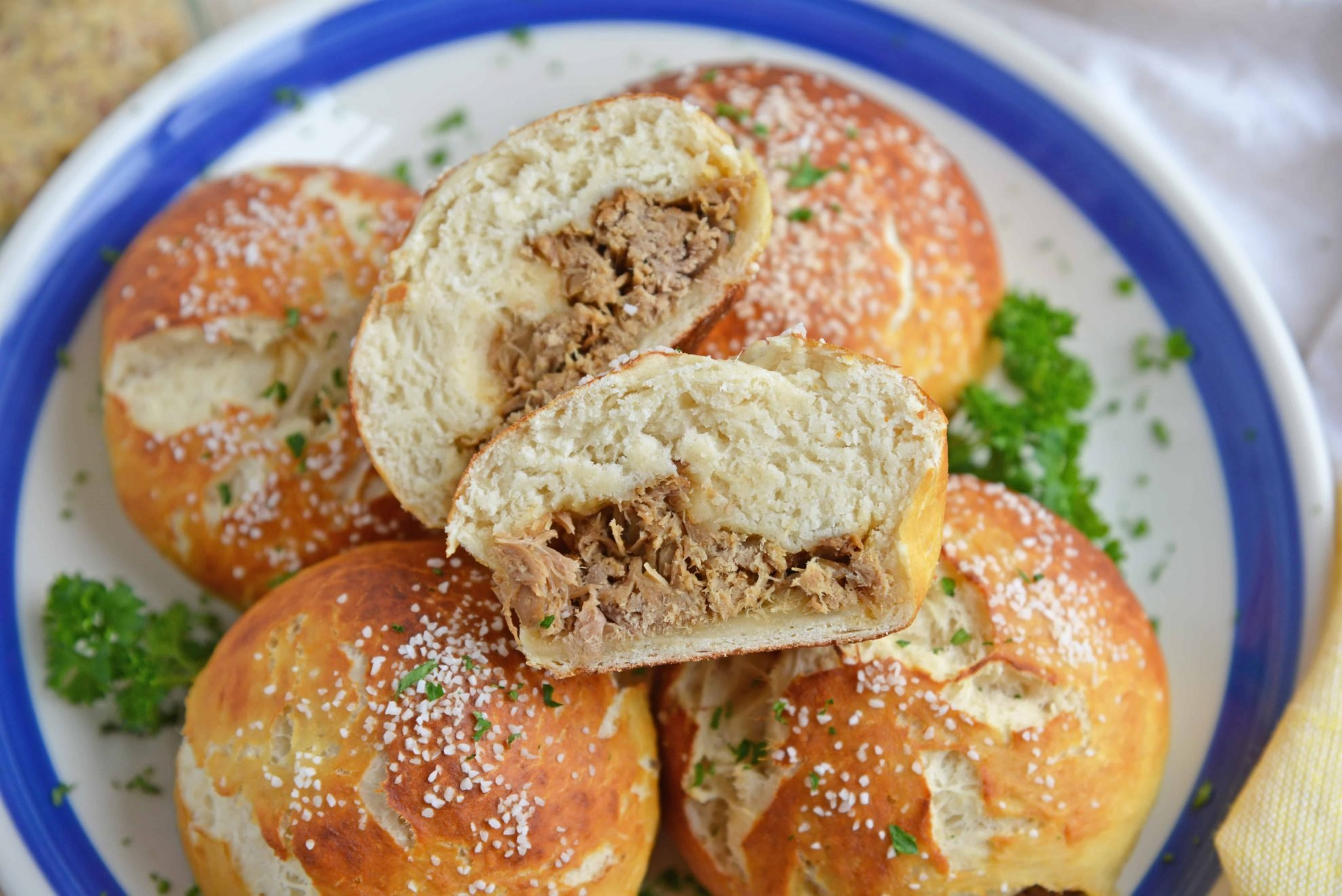 Platter of Pulled Pork Stuffed Pretzel Rolls