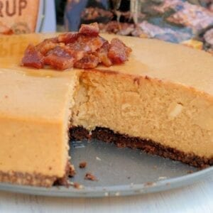 Candied Bacon Maple Cheesecake is made up of a maple cheesecake topped with candied bacon and a Salted Caramel Brownie Brittle ™ Crust! #cheesecakerecipe #easycheesecakerecipe www.savoryexperiments.com