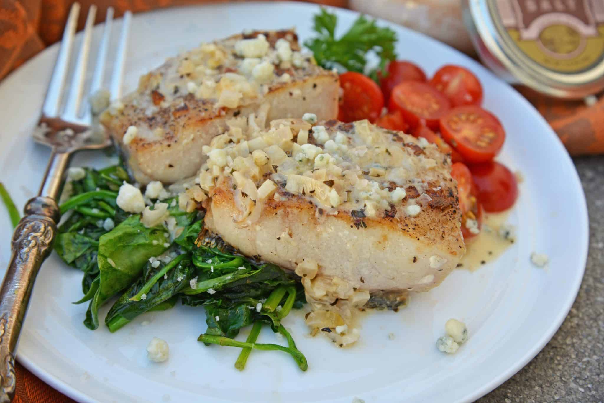 This Garlic Peppercorn Crusted Mahi Mahi recipe is serve with a sherry blue cheese cream sauce give it a restaurant quality flavor. #mahimahirecipes #howtocookmahimahi www.savoryexperiments.com