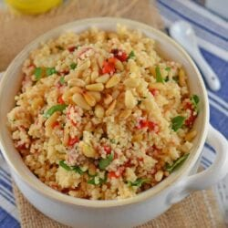 Italian Couscous is an easy side dish recipe perfect for serving with any meal. Sun dried tomatoes, garlic and pinenuts spruce up the dish!