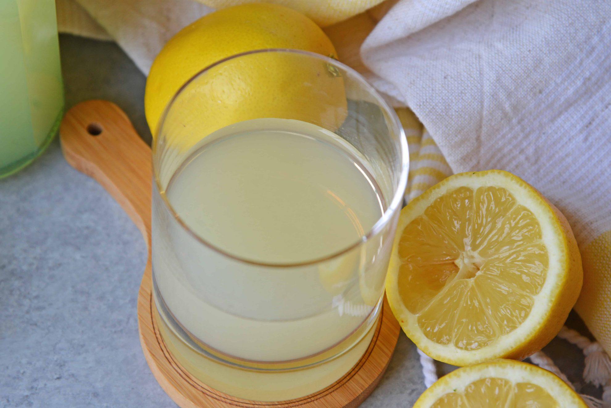 overhead angle limoncello with fresh lemons