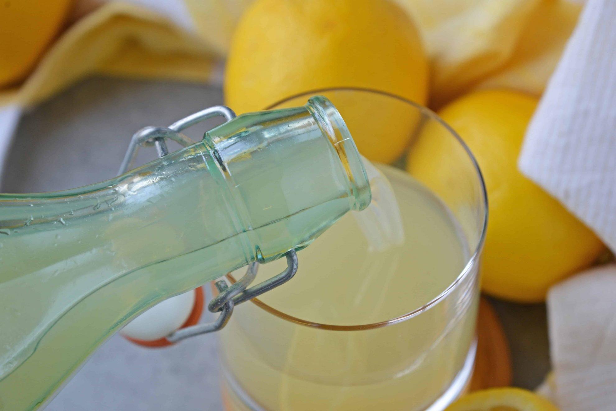 pouring limoncello into a glass