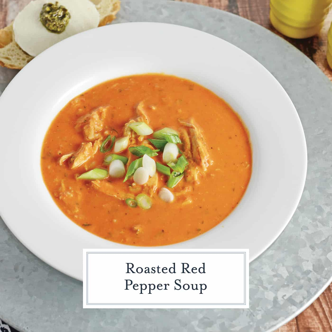 Roasted Red Pepper Soup is gluten and dairy free using hummus, roasted red peppers, pre-cooked chicken, and brown rice for a super quick and healthy soup! #roastedredpeppersoup #recipesthatusehummus #chickensoup www.savoryexperiments.com