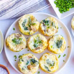 overhead of egg muffins on a white plate