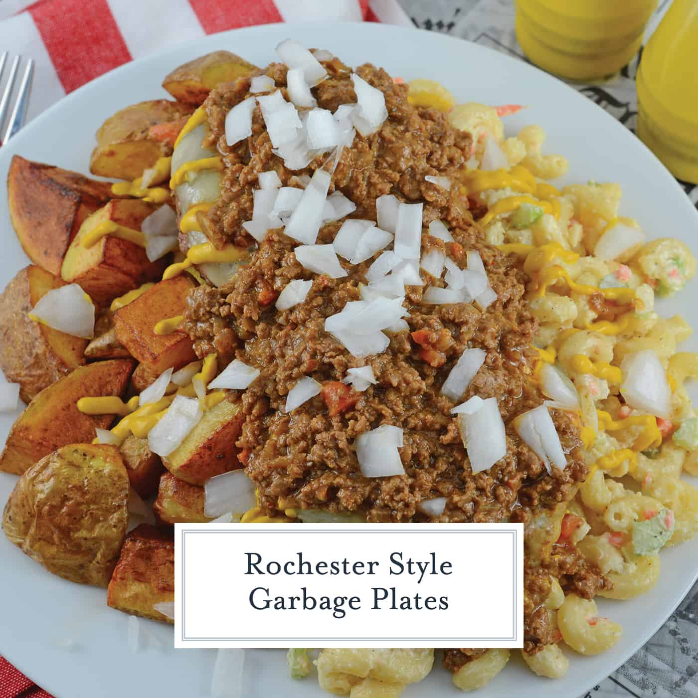 A Garbage Plate is a loaded dish of crispy home fries, hot sauce, macaroni salad and cheeseburgers topped with raw onions, condiments and slices of white bread. #garbageplates www.savoryexperiments.com