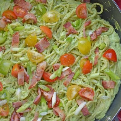 Healthy Creamy Avocado Pasta Sauce is a great alternative to traditional Alfredo sauce. Avocados, thick Greek yogurt, lemon juice, tomatoes and scallions make this wildly popular dish a favorite. Bacon optional! #avocadocreamsauce #creamyavocadopastasauce www.savoryexperiments.com