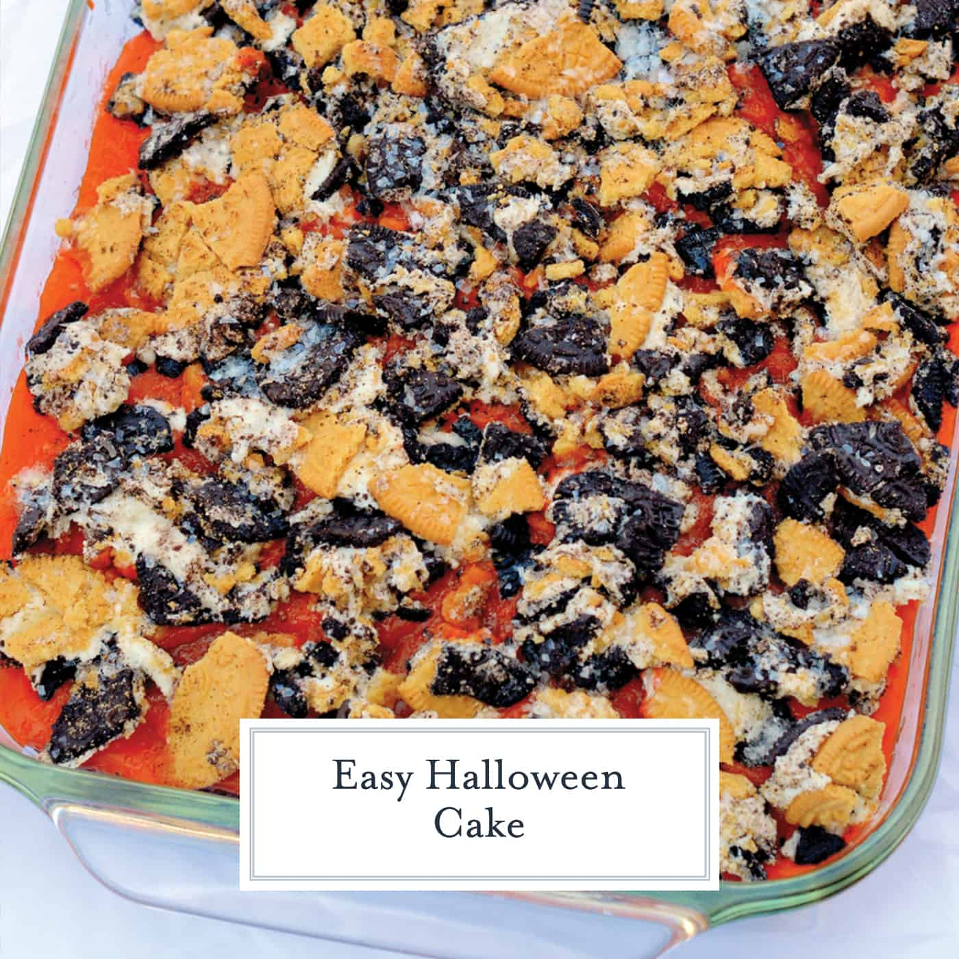 Easy Halloween Cake is a pudding poke cake made with cake mix, chocolate pudding and Halloween colored Oreo cookies. An easy and delicious Halloween dessert! #halloweendesserts #halloweencake #pokecake www.savoryexperiments.com