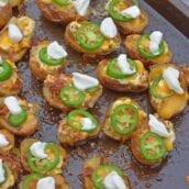 jalapeno popper potato skins on a baking sheet