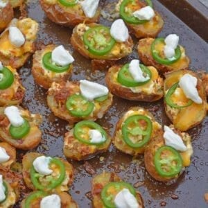 jalapeno popper potato skins on a baking sheet