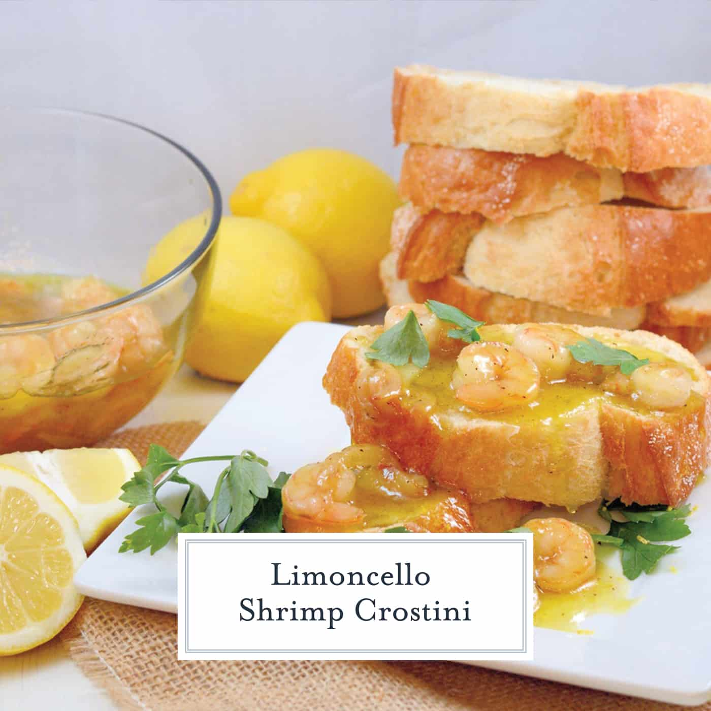 Limoncello Shrimp Crostini is made up of agrodolce sauce with shrimp, caramelized garlic and parsley spooned over crusty French bread! Ready in 20 minutes! #crostinirecipes #limoncello www.savoryexperiments.com