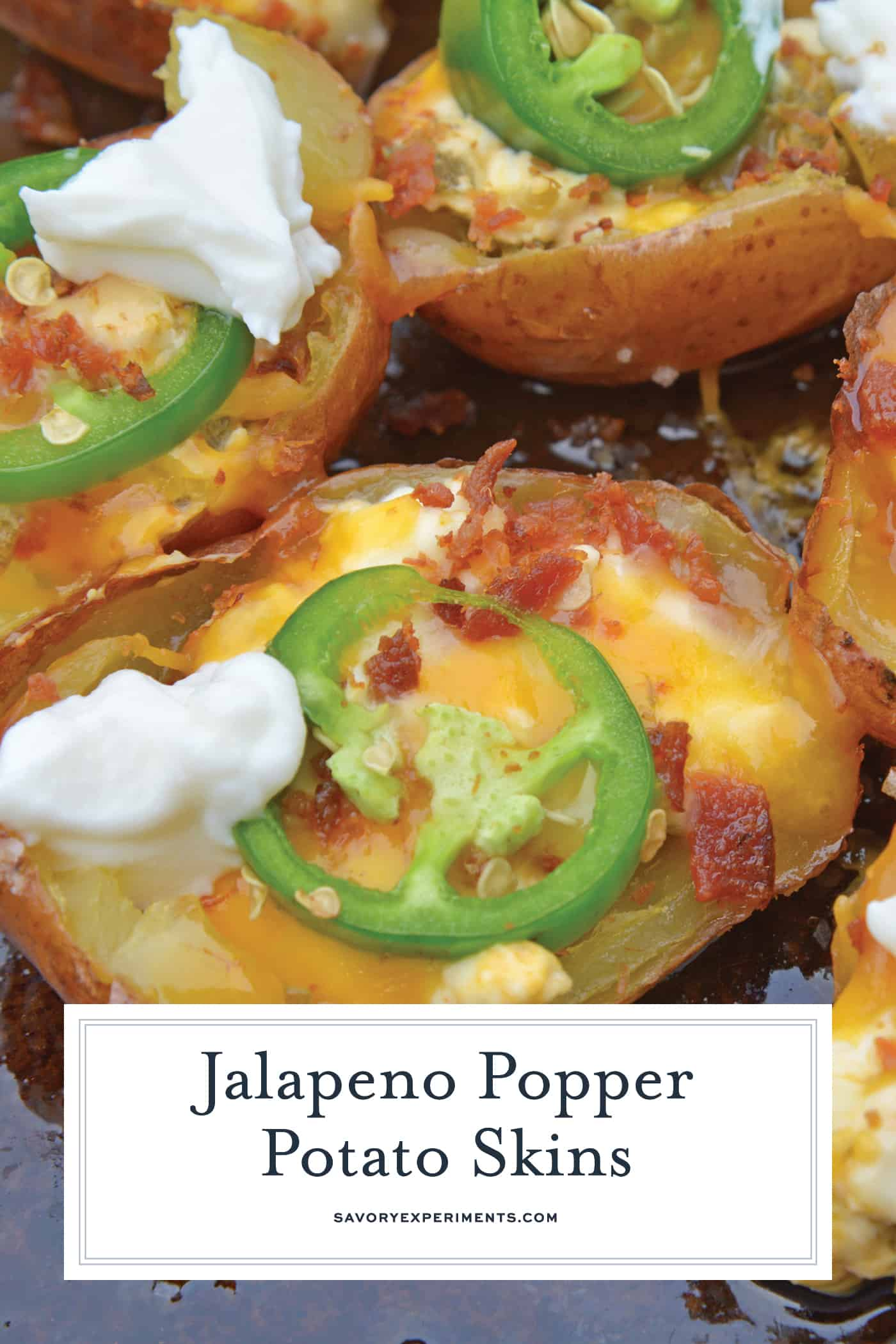 Jalapeno Popper Potato Skins are bite-sized potatoes filled with 3 types of cheese, fresh jalapenos, bacon and cooled off with sour cream. Perfect for a snack or party appetizer! #potatoskins #jalapenopoppers www.savoryexperiments.com