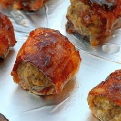 My BBQ Bacon Wrapped Meatballs are a little bit of sweet and savory heaven. Serve as an appetizer or a side for the game or any day of the week. #bacon #BBQbaconwrappedmeatballs #meatballs www.savoryexperiments.com