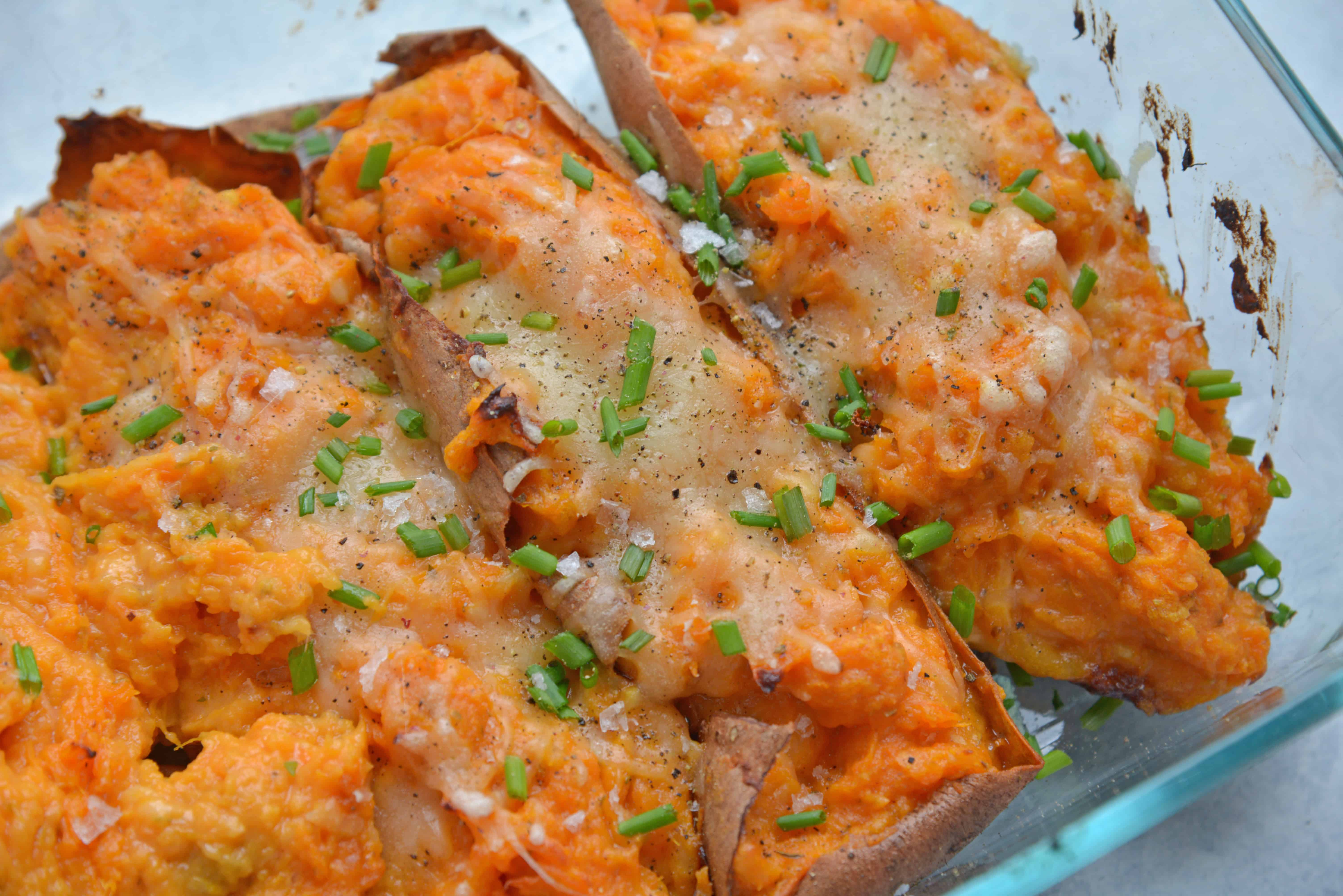 angle view of stuffed sweet potato with cheese and chives