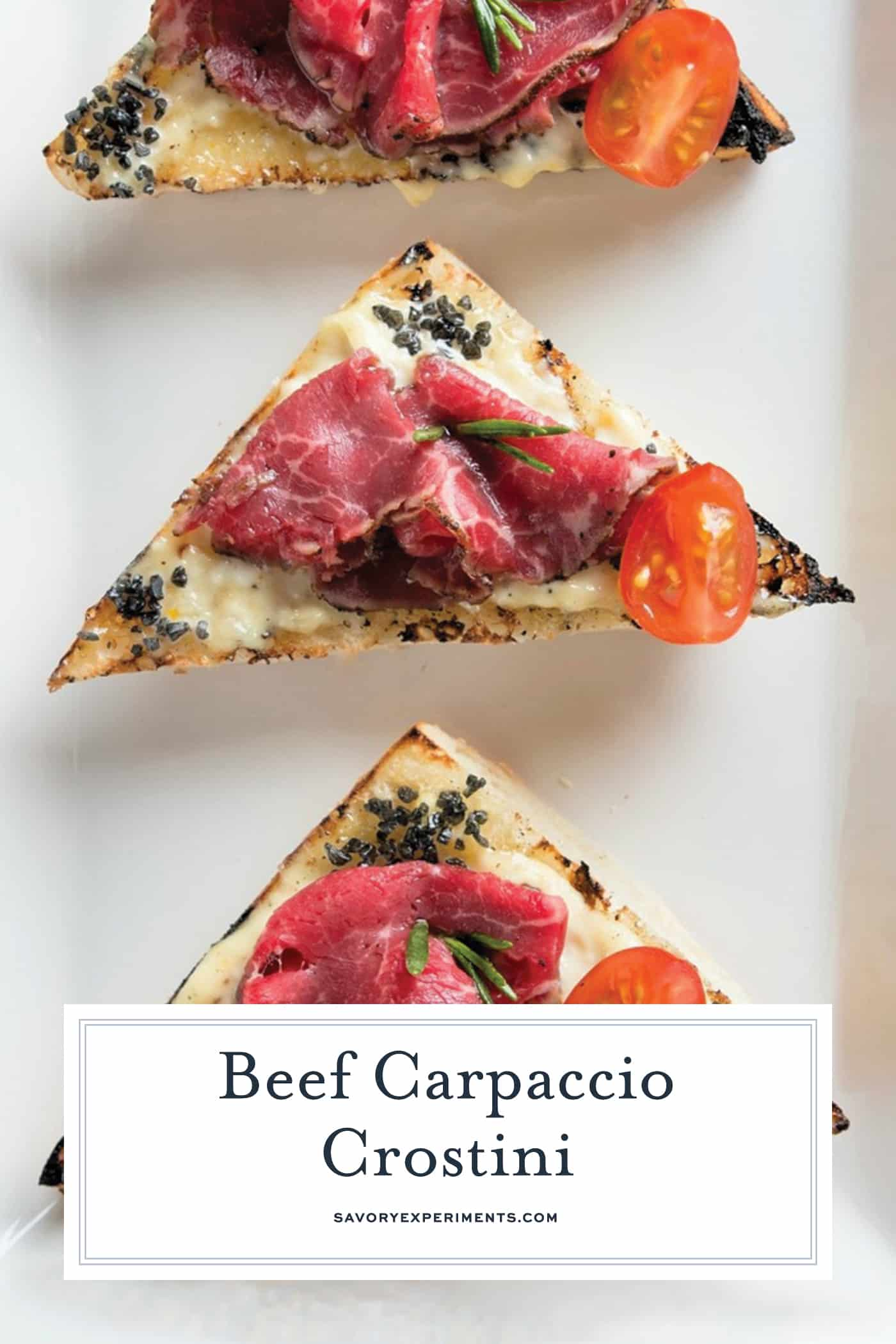 Beef Carpaccio Crostini are thinly sliced pieces of beef with garlic aioli, black sea salt and fresh rosemary with tomato. The perfect party appetizer. #beefcarpaccio #crostinirecipes www.savoryexperiments.com