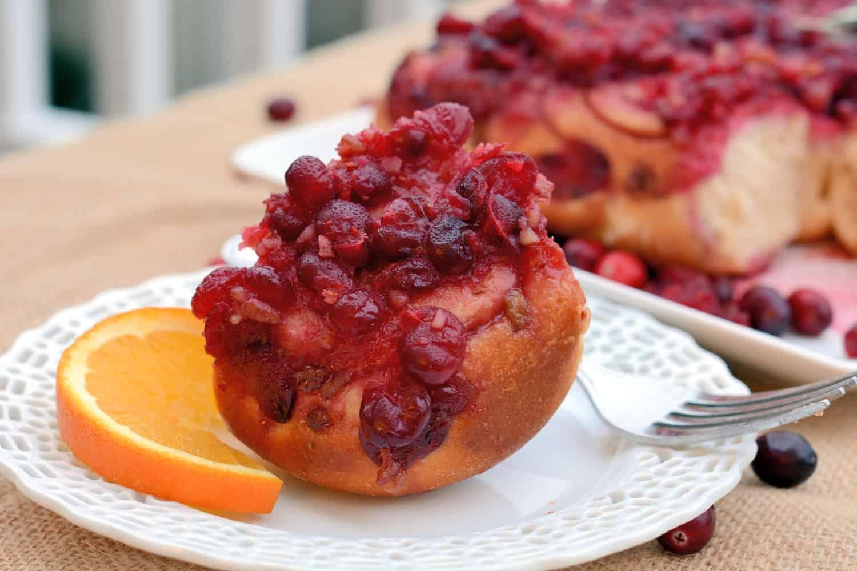 Cranberry-Orange Sticky Buns- Festive and tasty, cranberry-orange sticky buns make for the perfect holiday breakfast! #stickybuns #breakfast #cranberries www.savoryexperiments.com
