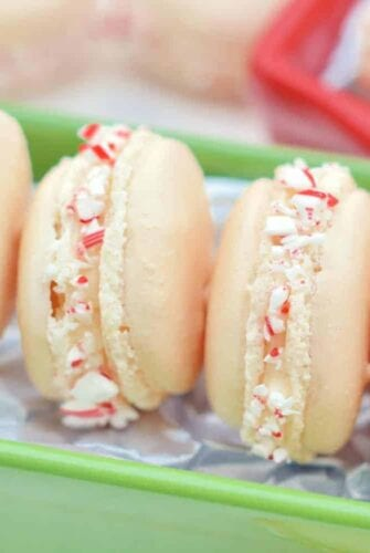 Peppermint Twist Macarons- The perfect chewy and slightly sweet holiday cookie treat. #macarons #christmascookies www.savoryexperiments.com