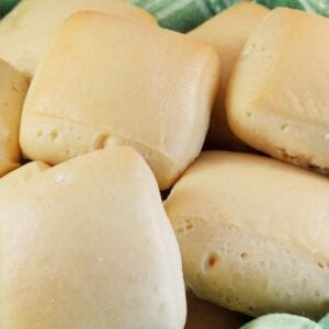 Even if you have never had Texas Roadhouse Rolls, you'll love these soft, pillow-like, buttery sweet dinner rolls. They are super easy to make! #texasroadhouserolls #dinnerrolls www.savoryexperiments.com