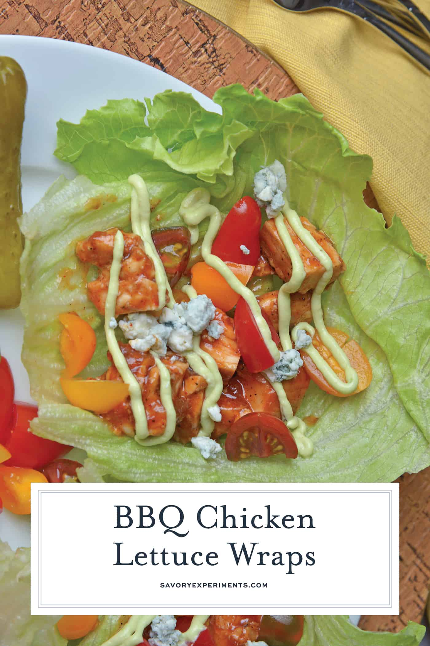 BBQ Chicken Lettuce Wraps use seasoned chicken with your favorite BBQ sauce and wrap them in crispy lettuce with juicy tomatoes, blue cheese and cool avocado dressing.#lettucewraps www.savoryexperiments.com