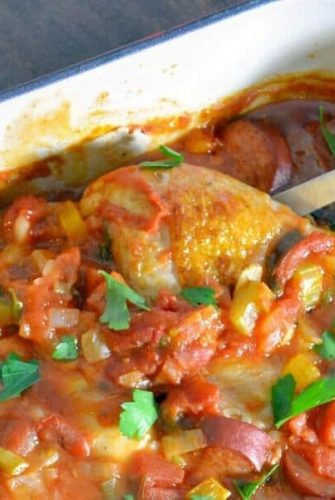 Creole Chicken is a baked chicken recipe using a spicy tomato-based sauce with vegetables and spices. Serve over rice. #spicybakedchicken www.savoryexperiments.com